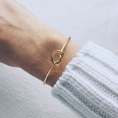 A white sweater and a gold bracelet - LadyStyle