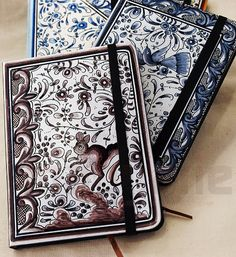 Handpainted note books by Isaura Marques