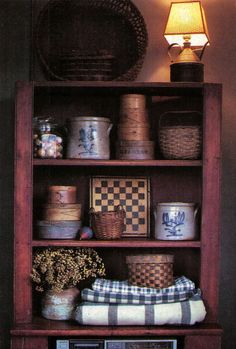 Primitive Crocks, Baskets & Boxes...love the homespun & gameboard.