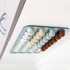 If we ever get a Nespresso machine, this rack is such a good idea - it holds up to 36 pods and you can stick it exactly where you want it - right above the coffee machine, please.