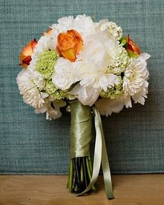 Orange tipped bicolor roses and white peonies