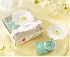 Hosting a baby shower and want inexpensive, unique party favors? Browse through beautiful, practical shower favors, or just fun baby shower games that fit within your budget and shower theme. Tea Wedding Favors, Party Favors, Indian Wedding Gifts, Garden Theme, Blossom Flower, Salt Pepper Shakers, Baby Shower Favors, Bridal Shower, Shower Gifts