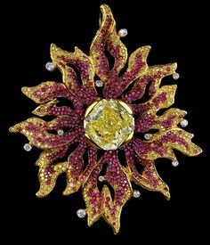 A big sparkler! From Jewellery Theatre: Elements Ring 18K Yellow Gold  1 fancy yellow diamond 12,5-12,80 ct 12 diamonds 0,40-0,50 ct 387 yellow diamonds 2,21-2,45 ct 758 rubies 4,85-4,95 ct