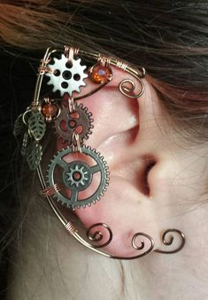 Wire Steampunk Gear Elf Ear Cuff from eclectikadesignsetsy on Etsy. Shop more products from eclectikadesignsetsy on Etsy on Wanelo. Chat Steampunk, Steampunk Fairy, Style Steampunk, Steampunk Gears, Steampunk Design, Steampunk Cosplay, Steampunk Clothing, Steampunk Fashion, Fashion Goth