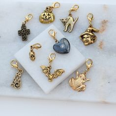 This delightfully eclectic collection of charms are gold plate or gold finished pewter and can be clipped on the charm bracelet by small gold plated lobster clasps. Silver Paper, Gold Paper, Black B, Silver Gifts, Gothic Wedding, Charms, Skull, Charm Bracelets, Lobster Clasp