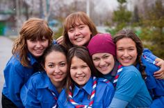 Girls of all ages wear blue shirts and national scarf that matches colors of Russian Federation flag. The shirt has all the badges that girls own.