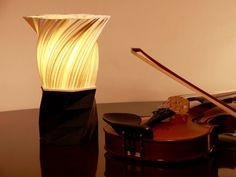 We're using the power of 3D printing to create unique and environmentally sustainable table lamps.