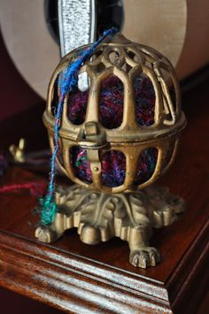 While on the continuous search for incredible Vintage pieces to restore to use this vintage cage-style string holder is gorgeous. The details are simply wonderful with lion paw feet, intricate leaf pattern design and is cast in iron.