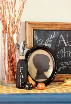 The perfect fall vignette! Love the silhouette portrait and the chalkboard bottle.