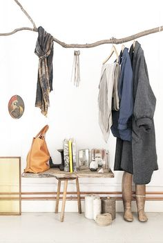Sweet idea for a coat rack in the wide hallway