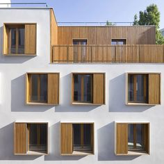 French studio Explorations Architecture have completed a social housing block beside one of the narrowest streets in Paris. The five-storey building provides eighteen apartments in a rundown neighbourhood in the centre of the city. Timber box-frame windows are staggered across a white stucco exterior to maximise natural light into each flat. Timber-lined balconies occupy recesses #fachadasarquitectura