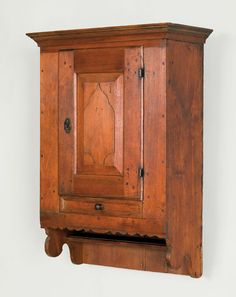"Pook & Pook.  October 30th 2010.   Lot 52.  Estimated: $4K - $7K.   Realized: $5214.  PA. walnut hanging cupboard, ca. 1765, having a cove molded cornice over a single raised astragal panel door, over a molded recessed panel drawer with scalloped apron & an open shelf flanked by cutout sides, 38 1/2"" h., 23 3/4"" w."