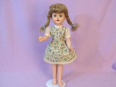 This Mary Lou Walking Doll sure looks like the one I had when I was a girl and still have.She was my last doll.