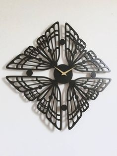 This clock is laser-cut from premium 1/4 birch plywood. Each piece is painted with custom blended stains and finished with non-toxic varnish. Product details: Dimensions - 22 x 22 x 1.5 Comes with gold hands, black hands are available upon request. One AA battery required - not