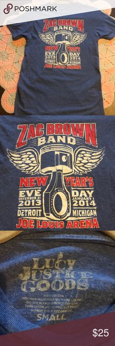 Zac Brown Band Detroit NYE Tee Zac Brown Band 2013-2014 New Years Eve show at Joe Louis Arena in Detroit, MI. JLA has been a historical landmark here in Michigan. It was home to the Detroit Redwings and many great concerts were held there. Sadly, JLA recently closed its doors and will soon be demolished. Lucy Justice Goods Shirts Tees - Short Sleeve