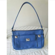 """❄️️ 5th DAY OF CHRISTMAS Banana Republic Purse Bag 🎄 5TH DAY OF CHRISTMAS PRICE DROP! ON SALE FROM $45 TO ONLY $10 UNTIL DECEMBER 20TH! The perfect Christmas gift! Satisfaction guaranteed. Never Been Carried or Used. Made Of Blue Leather. 100% Authentic. Silver Hardware. Zipper Closure and Large Zipper Pocket On Inside. Tan with BR lining makes it easy to find things. 8"""" height, 12"""" Length, 3"""" Depth. Free gift with every purchase. Feel free to ask any questions. Bundles (discount) and…"""