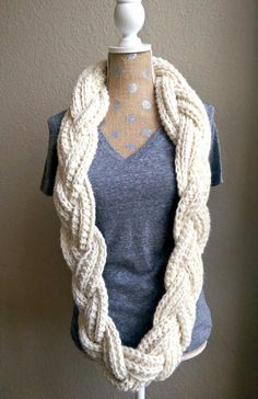"An elegant ""twist"" on the classic, crochet infinity scarf. This braided scarf pattern is so simple to create and works up into a head turning, unique pie"