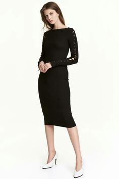 5e3182df491c Fitted dress in ribbed jersey with a slight sheen. Wide neckline and lacing  from the shoulders down the sleeves.