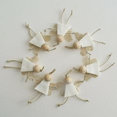 Angels.  This looks like a simple project to make. Cute to put on the childrens  pkgs at preschool.