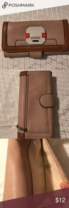 Guess Wallet👛 Beautiful Guesd Wallet. Very roomy. Minor ware and tare and minor stain inside the outer pocket as shown on pictures.PRICED TO SELL Guess Bags Wallets