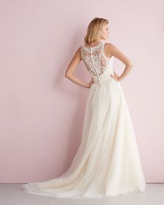 Loving this dramatic illusion back from Allure Bridals. From @weddingshoppe