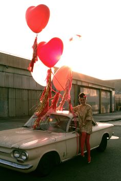 this is just fun, anyway you look at it - the balloons, her great dress, the tights, the car...