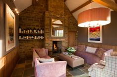 Open plan living space with roaring fire at Chescombe Lodge. Enjoy an evening sat around the fire and relax to your favourite music played through the Ipod docking station. Don't forget to pack your Ipod!