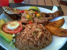 A West Indian lunch! Fry fish, plantains, rice and peas., avocado and salad. #Food # Looks so good!