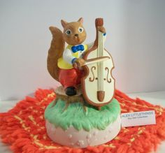 Hey, I found this really awesome Etsy listing at https://www.etsy.com/listing/221790570/squirrel-playing-cello-music-box