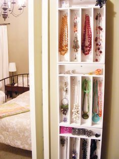 DIY costume jewelry organizer made from 3x bamboo cutlery trays + screws & spray paint. Another great idea. She mounted in her closet, wouldn't fit in mine, but would go nicely behind my bedroom door. #closetorganizerideas