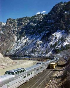 Two California Zephyr express trains meet at a railroad siding (Grizzly) in Garfield County, Colorado beside the Colorado River on March 21, 1949.