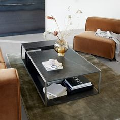 New Philadelphia coffee table by Henrik Pedersen is monolithic in form but is designed with multifaceted compartments that becomes your playground for storage. Made from durable materials such as ceramic top and steel framework, Philadelphia is scratch and heat resistant, to ensure a longer life span for everyday use. Featured here with the Carmo sofa and Loom rug.