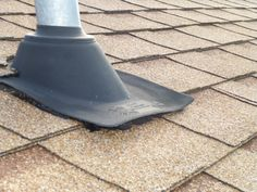 Hey does the roof boot go underneath or on top of the shingles? (electric mast neoprene flashing boot lifted & leaking)