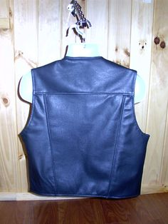 "BACK of mens black leather vest. Fits size 44"" chest. Reg. $245.00 SALE $185.00."