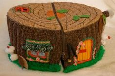 DIY Fabric tree stump doll house! So cool! Reveals one room on each side, fully furnished!