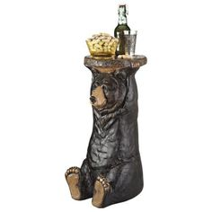 Whether you're greeting your guests or lounging on your patio, the Black Forest Bear Pedestal Table from Design TOSCANO will add something special to your decor. This painstakingly designed table depicts a bear holding up a tray for you. Rustic End Tables, Outdoor Side Table, Outdoor Dining, Wood Pedestal, Rustic Cabin Decor, Rustic Cabins, Bear Design, Garden Statues, Outdoor Statues