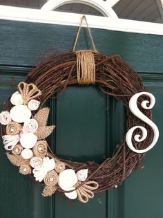 Rustic wreath with burlap and felt handmade flowers, and wood letter painted and distressed.