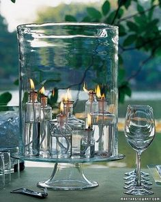 glass vases inside large glass hurricane; nice