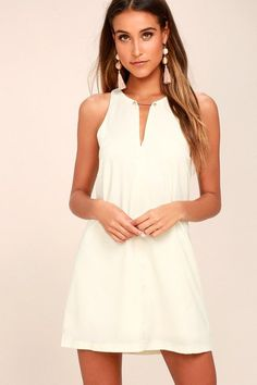 Lulus Exclusive! Wear the Near or Bar Cream Shift Dress here, there, and everywhere in between! Lightweight woven fabric is perfectly breezy across a sleeveless bodice with a deep V-neck that is joined by a shiny gold bar. Side darting tops the shift silhouette. Back keyhole with top button.