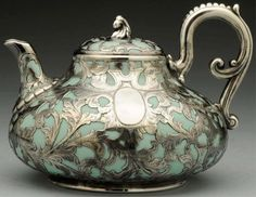 Crooks and Nannies silver overlay teapot. I want this too.