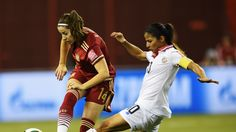 Vicky Losada of Spain is challenged by  Shirley Cruz of Costa Rica