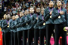 2 of 45  Men's basketball team    Members of Team USA listen to the national anthem after winning the gold medal Sunday by defeating Spain 107-100 in a rematch of the 2008 final in Beijing.  Members of Team USA listen to the national anthem after winning the gold medal Sunday by defeating Spain 107-100 in a rematch of the 2008 final in Beijing.