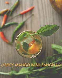 SPICY MANGO BASIL SANGRIA  For 2 large pitchers  1/2 cup palm sugar or dark brown sugar  2 mangos, peeled and chopped  4 Thai chilies, finely sliced (more if you like it really spice)  serrano chilies work too  1 bunch Thai basil, leaves removed and roughly torn  if you can't find this, regular fresh basil will work too.  3 bottles of white or rose wine (something with a bit of residual sweetness)