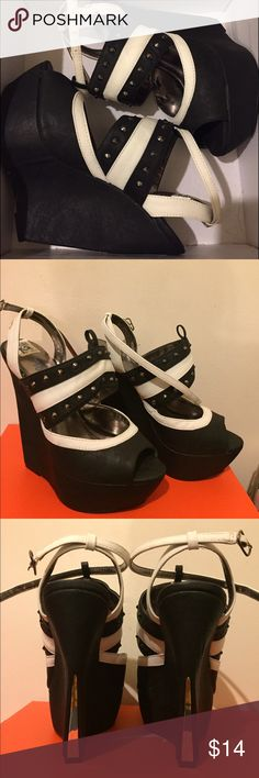 Black and White platforms Black and white platforms. 4-5 inches high. Buckle around ankle. Charlotte Russe Shoes Platforms