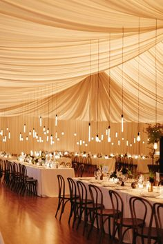 Elegant Wedding via once wed. Gorgeous lighting and design by @BASH, PLEASE --This reminds me of the Harry Potter floating candles! And I love those french bistro chairs!