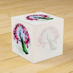 http://www.zazzle.com.au/peacock_cherry_blossoms_and_lattice-256826704023096111?rf=238523064604734277 Peacock Cherry Blossoms And Lattice - This favor box features a peacock perching on a cherry blossom branch in front of a lattice wall. You can write text over the lighter images.