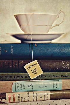 A cup of tea sitting on a stack of books.