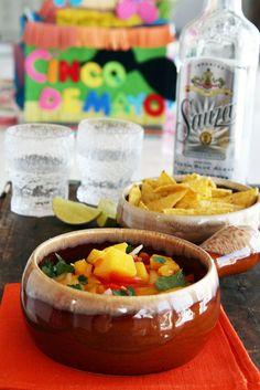 Mango salsa recipe for Cinco de Mayo parties. INGREDIENTS 2 mangos 1 red pepper 1 onion 1 lime's juice 1/2 jalapeño chopped cilantro dash of salt