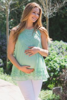 This chic maternity blouse is perfect must have this season. Pretty crochet accents and chiffon material, this stylish blouse will be your new favorite. Style this top with your favorite maternity jeans and flats for a complete look.