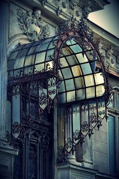 """gatsbywise: """" Nicely designed iron and glass entry cover - """""""